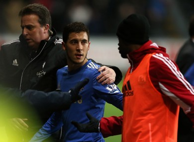 Chelsea's Eden Hazard leaves the pitch after being sent off.