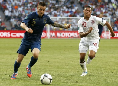 Debuchy (left) with England's Alex Oxlade-Chamberlain at Euro 2012.