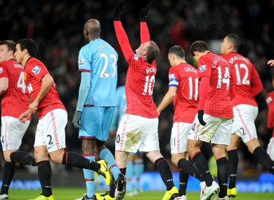 Manchester United's Wayne Rooney (centre) celebrates scoring his team's first goal.