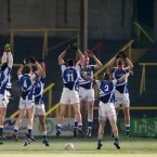 Warm-ups are essential to gaining body heat. The Laois players jump in unison in O'Moore Park.
