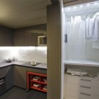 Wardrobes hidden in closets, a foldaway table and under-the-counter appliances in the model apartment. (AP Photo/Seth Wenig)