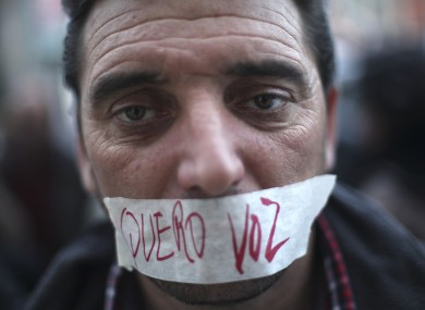Portuguese worker Luis Silva at an anti-austerity protest last month. The tape over his mouth reads: