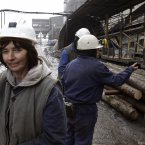 Woman cCtechnologist, walks away from her colleagues at the entrance to the shaft of the coal mine in Breza, 20 kms north of Sarajevo, after completing her 8-hour shift at 450 meters under ground.