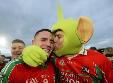 Ballymun's Davey Byrne celebrates with fan Darragh Joyce.