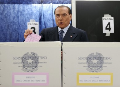 Former Premier Silvio Berlusconi casts his ballot in Milan today