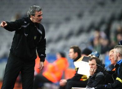 Donegal manager Jim McGuinness argues with the fourth official during final moments of the match.