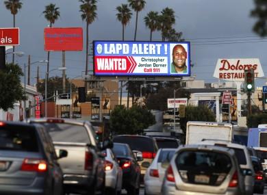 A digital billboard along Santa Monica Boulevard on the west side of Los Angeles shows a