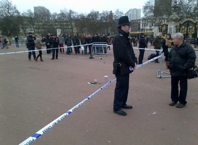 A cornered off area containing knives, a hat and Taser wire outside Buckingham Palace.