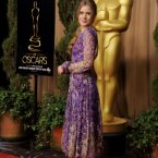 At last!  Some colour from Amy Adams.  We like this swishy frock. (Chris Pizzello/Invision/AP)
