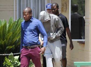 Paralympic Athlete Oscar Pistorius leaves the Boshkop Police Station ahead of a visit to hospital for medical examinations.