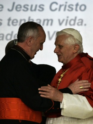 Then-pope Benedict XVI greets the former Cardinal Jorge Bergoglio during a visit to South America in 2007. The two will meet again today for the first time since Bergoglio himself became pope.