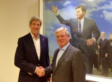 John Kerry and Eamon Gilmore shake hands at Shannon Airport earlier this month