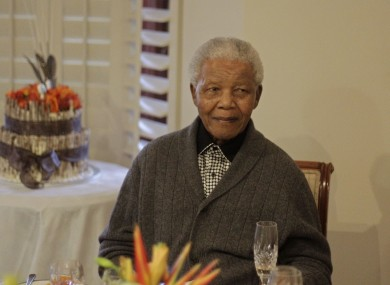 Former South African President Nelson Mandela celebrating his 94th birthday in Qunu, South Africa, on 18 July, 2012 (file photo).