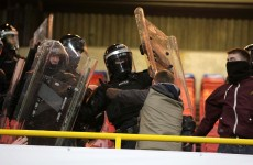 PSNI clash with section of Shamrock Rovers fans during Setanta Cup game at Windsor Park