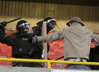 A Rovers supporter tries diplomacy with a PSNI officer.