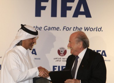FIFA president Sepp Blatter, right, and Qatar Football Association (QFA) President Sheik Hamad Bin Khalifa Bin Ahmed al-Thani exchange documents (file pic).
