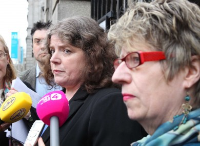 Dr Bernie McCabe, centre, outside Leinster House yesterday when details of 113 psychiatrists' concerns about abortion law were explained to politicians.
