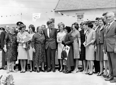 During his three-day visit to Ireland, U.S. President John F. Kennedy meets with his Irish cousins in the barnyard of their mutual forefather's homestead, at Dungansto