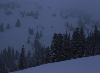 Snow falls near the spot where five members of a backcountry snowboarder group were found dead after they were trapped by an avalanche on Loveland Pass, Colorado, yesterday.