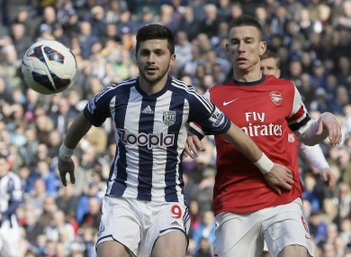 West Bromwich Albion's Shane Long, shields the ball from Arsenal's Laurent Koscielny during their English Premier league soccer match.