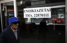 Cyprus eases controls on stricken banks – but keeps €300 withdrawal limit