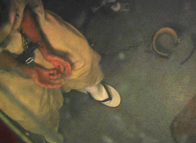 In this April 16, 2013 video frame grab reviewed by the U.S. military, a shackled detainee meets with medical personnel in Camp 6, at Guantanamo Bay Naval Base, in Cuba.