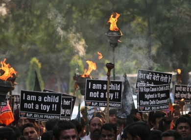 Activists protest against the rape of another young girl (5) in New Delhi, India.