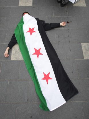 A member of the Federation of Student Islamic Societies in Dublin takes part in a flashmob last March on O'Connell Street to highlight human rights abuses by the Assad regime