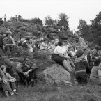 The crowd of people, young and old, at a Mass Rock in the Mournes find themselves temporary perches on the hillside among the rocks, the ferns and bracken.