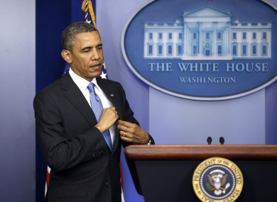 President Barack Obama returns to the podium to answer an additional question during his new conference in the Brady Press Briefing Room.