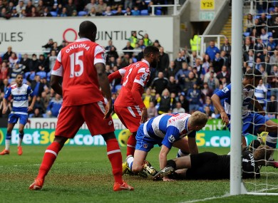 Queens Park Rangers' Jose Bosingwa (right) clears the ball off the line during the game against Reading.