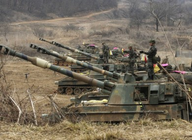 South Korean marines stand on their K-55 self-propelled howitzers during an exercise against possible attacks by North Korea near the border village of Panmunjom.