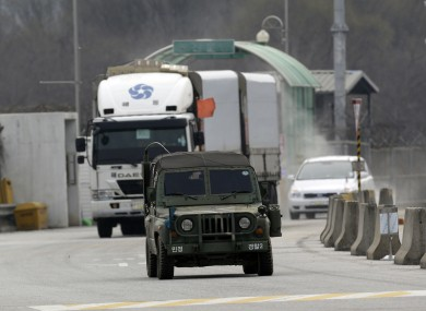 South Korean vehicles returning home from North Korea's Kaesong complex are escorted by a South Korean military.
