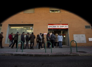 People queue to enter on an unemployment office in Madrid, Spain