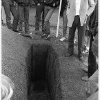 The teenagers in particular seemed fascinated by the open grave and stood around staring into it.