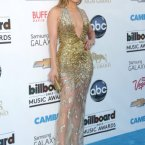 J-Lo went with a classic look for the blue carpet.  She's 43 lads.  She looks unbelievable.  John Shearer/Invision/AP