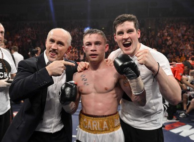 Frampton celebrates his European title win with Barry McGuigan, left, and trainer Shane McGuigan.