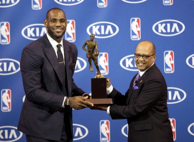 Miami Heat's LeBron James with his fourth Most Valuable Player award.