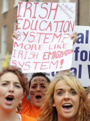 Thousands of teachers protest outside Leinster House over cuts and equal pay in October.