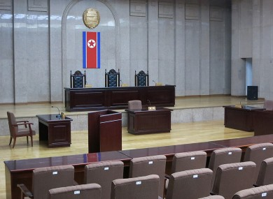 A North Korean flag hangs inside the interior of Pyongyang''s Supreme Court.