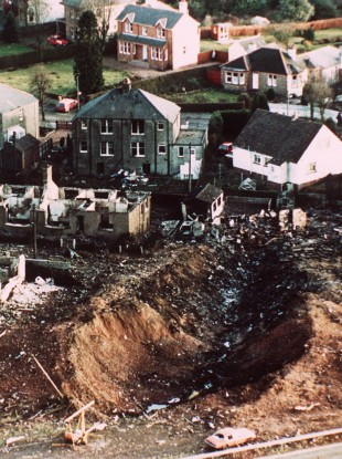 Wrecked houses and a deep gash in the ground in the village of Lockerbie, Scotland - damage caused by the crash of Pan Am Flight 103 Dec. 21, 1988.
