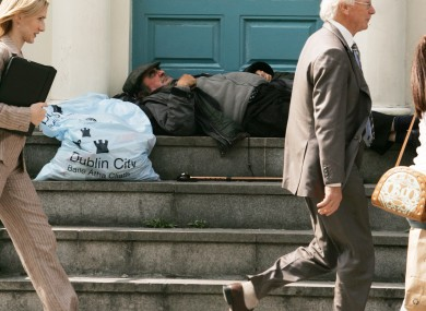 A person asleep in a doorway in Dublin city centre.