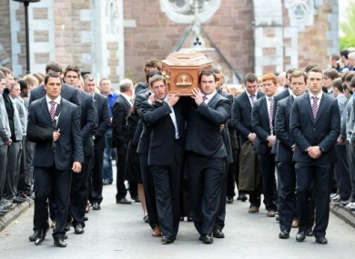 The Munster squad escort Donal Walsh's coffin.