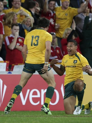 Adam Ashley Cooper and Israel Folau celebrate the winger's first try.