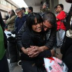 Jonathan Fuentes hugs his girlfriend Vivian Alvarez as they wait for the shelter to open for the evening at the indoor stadium Estadio Victor Jara which opens its doors to the homeless for winter in Santiago, Chile. The stadium, which opened its doors on May 15 as a temporary shelter to house people throughout the winter who normally sleep on the streets, is where Chilean folksinger Victor Jara was tortured and killed in 1973, just days after Chile's bloody 1973 military coup. Today the stadium is named after him and is Chile's largest homeless shelter. (AP Photo/Brittany Peterson)