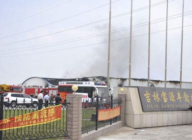 Smoke rises from a poultry farm at the Jilin Baoyuanfeng Poultry Company in Mishazi township of Dehui City.