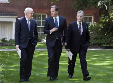 Prime Minister David Cameron walks with Northern Ireland's Deputy First Minister Martin McGuinness and Northern Ireland's First Minister Peter Robinson earlier in the garden of 10 Downing Street in central London.