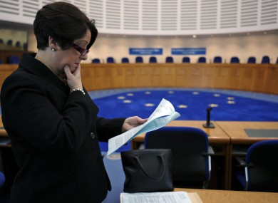 Carmel Stewart, a lawyer for A, B and C, reads the European Court of Human Rights' ruling in the case in December 2010.