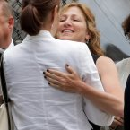 Actress Edie Falco embraces a woman as she arrives for the funeral service (AP Photo/Richard Drew)