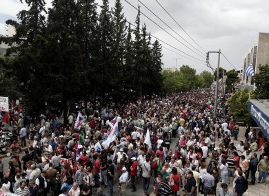 Thousands of protesters take part in a rally outside the Greek state television ERT headquarters during a 24-hour general strike in Athens today.